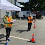 Volunteers standing on the road