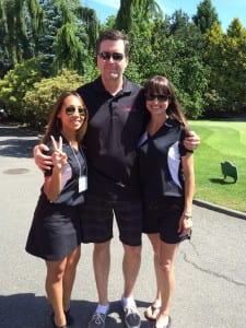 Man with two ladies posing for photo