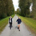 Men walk in the empty road