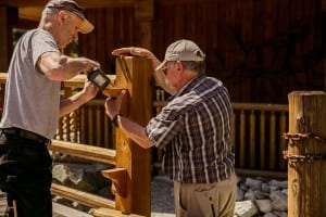 Two men working on the wood